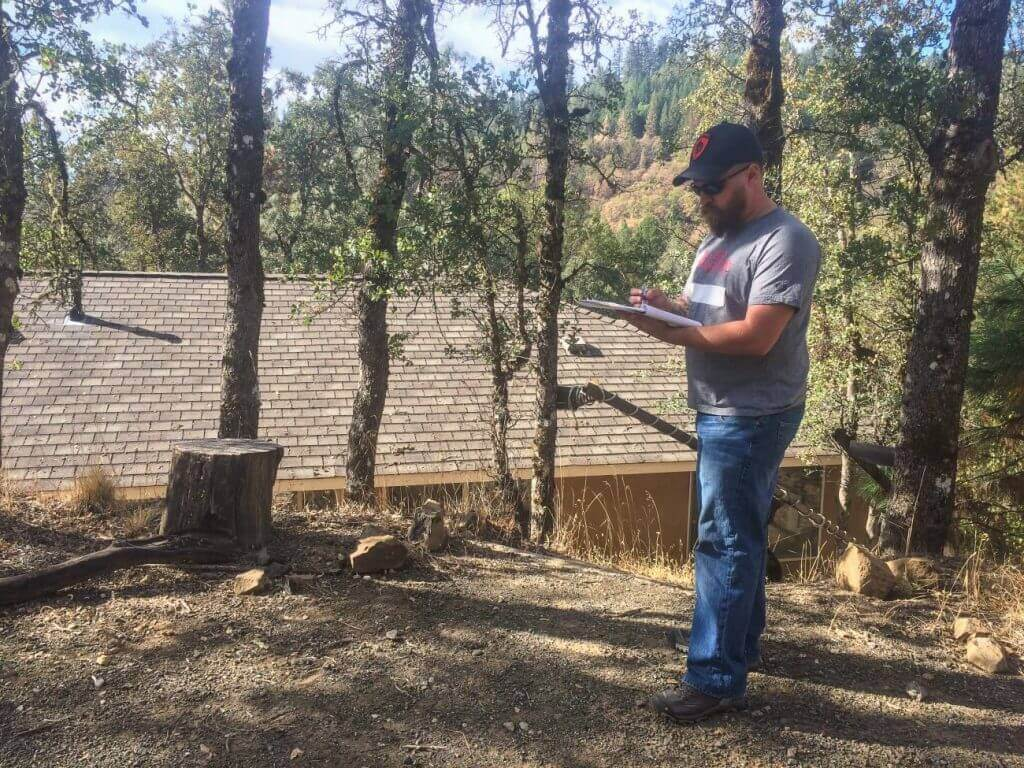 Army veteran Jason Keller logs damage assessments during Operation: Mountain Woman in Lake County, CA.