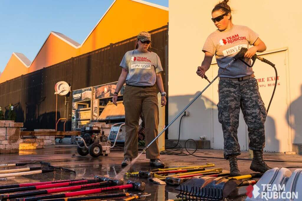 Army veterans Merissa Morgan (left) and Hayley Albers (right) tackle some end-of-day decon in Glenn Heights, TX.