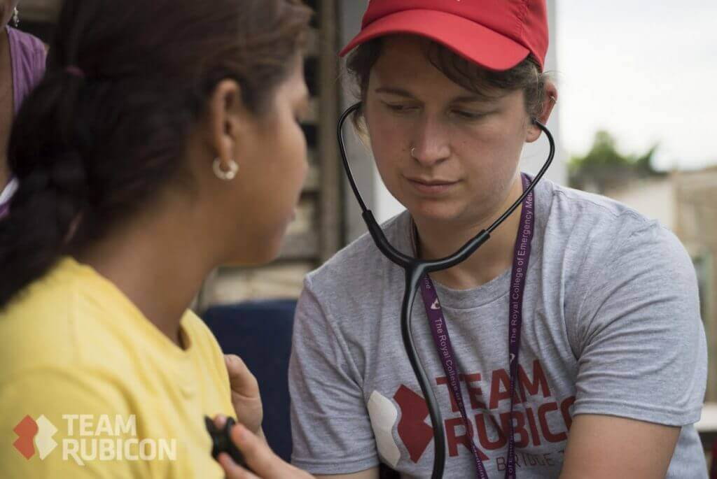 Team Rubicon UK member Emma Butterfield provides a health assessment on a young girl in Bahia, Ecuador. Team Rubicon volunteers are currently conducting disaster and medical assessment in Ecuador after an earthquake recently caused devastation in the country.